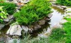 Искусственный водоем на крутом рельефе